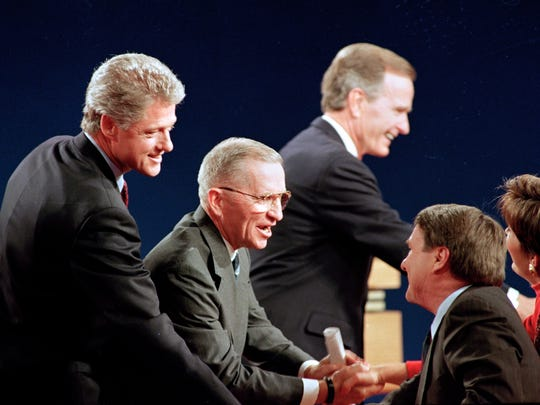 Bill Clinton, Ross Perot and George Bush following their third and final presidential debate at Michigan State University in 1992.