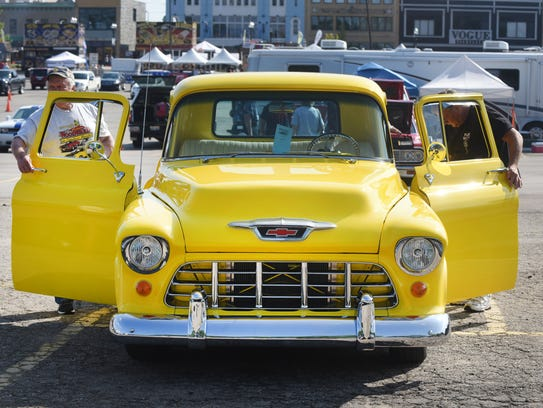 A 1955 Chevy yellow monster is seen at the Pike Street