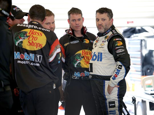 Tony Stewart talks to his crew following the first practice for the Crown Royal Jeff Kyle 400 at the Brickyard, July 24, 2015, at the Indianapolis Motor Speedway.