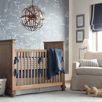 Dramatic, oversized art can be a great way to decorate a child's contemporary room. RH Baby & Child offers several murals, including an illustration of the constellations.
