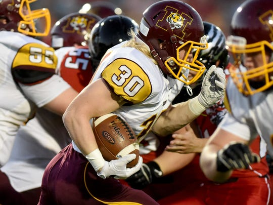 Harrisburg's Jack Anderson carries the ball against