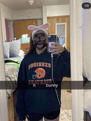 """Bridgewater State University officials are investigating a photo posted to social media that shows a white female student wearing blackface, bunny ears and an Uxbridge Spartans sweatshirt, that has the N-word, then the word """"bunny,"""" overlaid on top of it."""