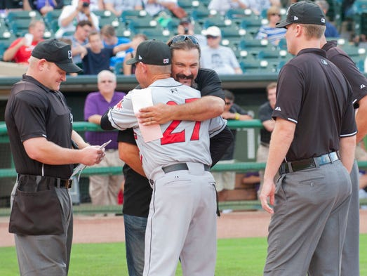 Corky Miller was given the honor of presenting the official Louisville Bats lineup card to the home plate umpire at the start of the game. When Indianapolis Indians manager Dean Treanor presented his card, the two hugged at home plate. Miller's #8 was retired by the Louisville Bats tonight, the first number the team has retired, in honor of its long-time catcher. 31 August 2014