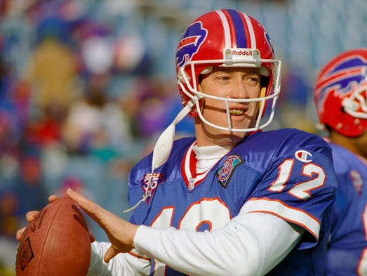 Jim Kelly threw for 35,467 yards and 237 touchdowns in his NFL career.