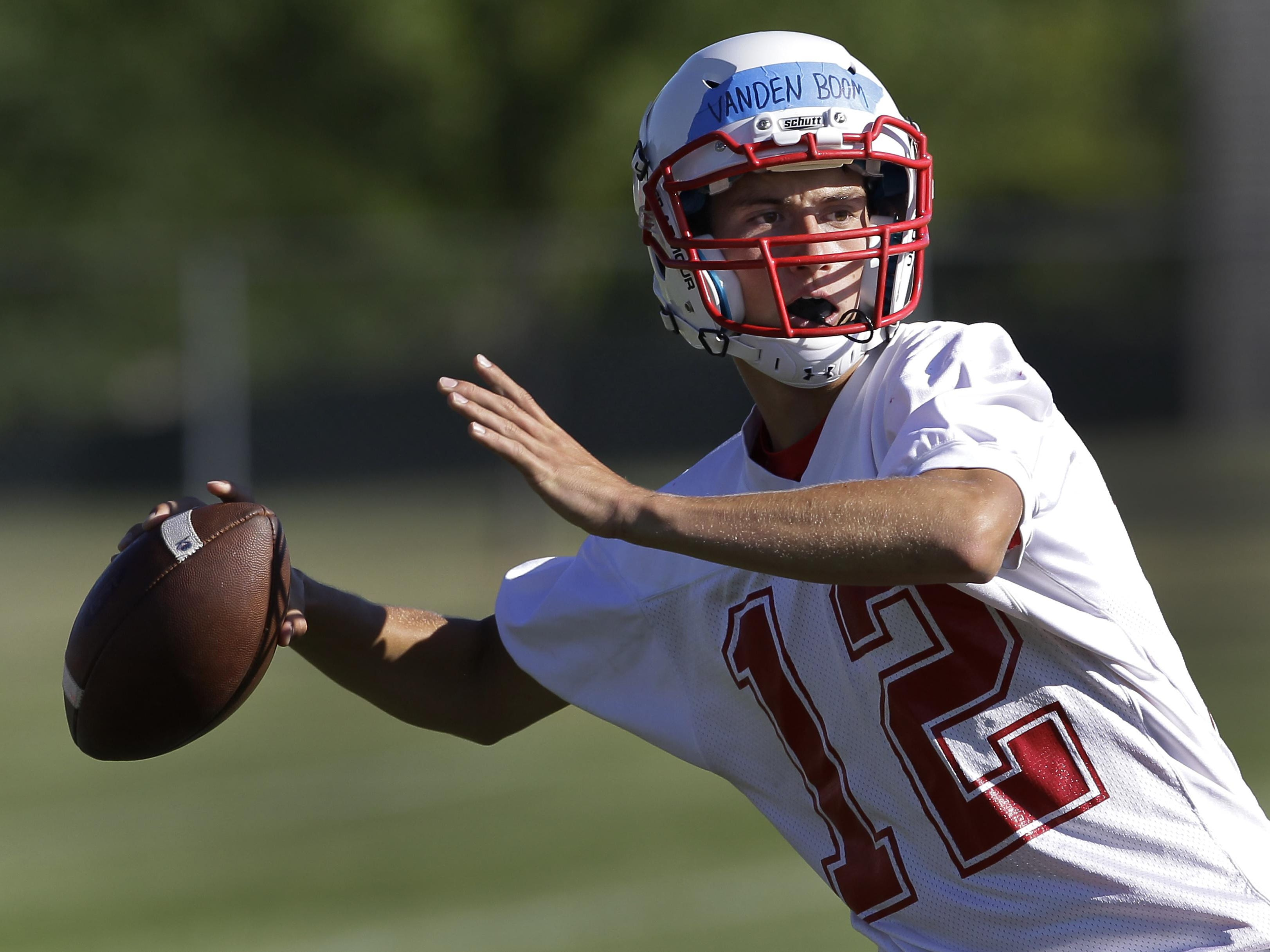 Kimberly High School's quarterback Danny Vanden Boom throws a pass during football practice Tuesday, Aug. 4, in Kimberly.