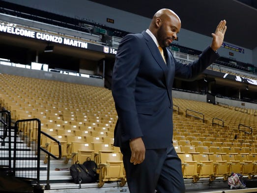 Cuonzo Martin waves as he walks out to be formally