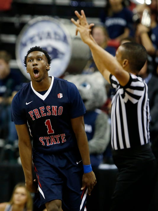 Fresno State's Jaron Hopkins reacts after sinking a three-point basket during the first half of an NCAA college basketball game against Nevada in the Mountain West Conference tournament semifinals Friday, March 10, 2017, in Las Vegas. (AP Photo/Isaac Brekken)