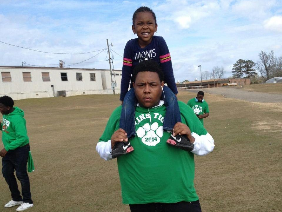 Jabarri Goudy holds his sister, Taylor, 5, on his shoulders. Goudy, 17, was killed in a shooting outside a Hattiesburg nightclub in July.