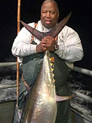 Frank Pogue, Willingboro with a 140-pound bigeye tuna he caught on the 125-foot Jamaica.