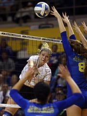 ASU's Mallory Blauser spikes the ball past the Texas