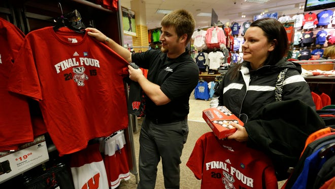 Devan Kuether, left, and Becky Ludwig, both of Oshkosh, shop for Wisconsin Badgers Final Four T-shirts on Monday at Scheels in Grand Chute.