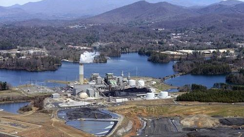 In this file photo, heavy machinery works to move coal ash at the Duke Energy power plant south of Asheville.
