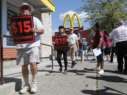 In this July 22, 2015, file photo, supporters of a $15 minimum wage for fast food workers rally in front of a McDonald's in Albany.