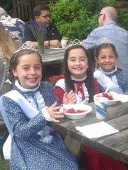 Children eat strawberry shortcake at the Strawberry