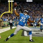 Detroit Lions running back Theo Riddick (25) celebrates a touchdown during the second half of an NFL football game against the Miami Dolphins in Detroit, Sunday, Nov. 9, 2014.