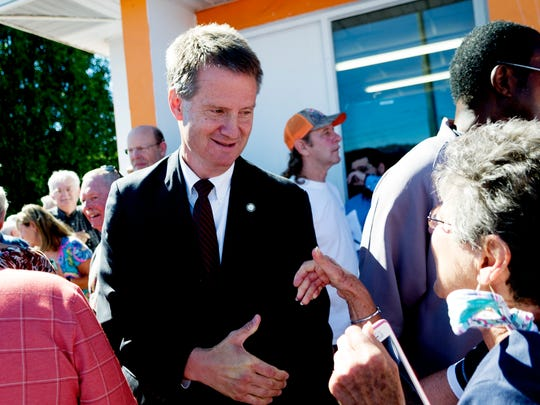 Knox County Mayor Tim Burchett shakes hands with supporters after announcing his candidacy for Congress during a ceremony at Vol Market #3 on Western Avenue in Knoxville on Aug. 5, 2017.