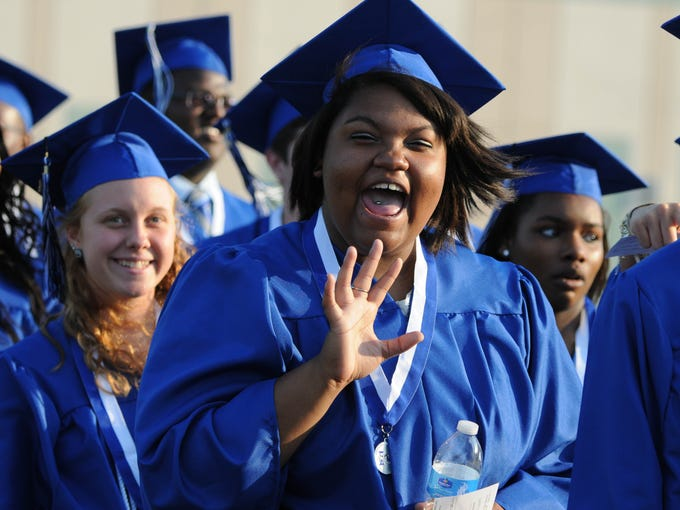 Students march into the stadium for the Heritage High graduation.