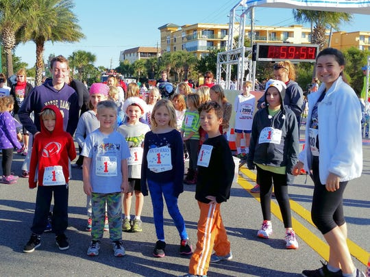 Rachel White (R), the recipient of the inaugural Coach Bernie Scholarship, has been volunteering consistently within the Space Coast running community since she was three years old.
