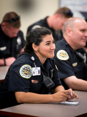 Officer Cecilia Gomez listens during roll call at the start of her shift at the Metropolitan Nashville Police Department Madison Precinct on July 7.
