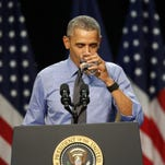 President Barack Obama drinks a glass of water as he delivers remarks at Northwestern High School in Flint.