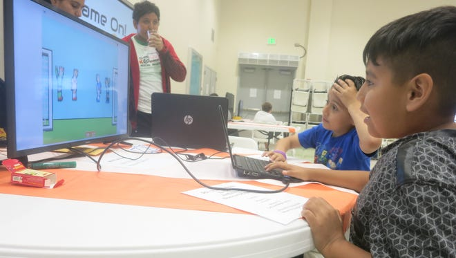 """Uriel Ortiz and Brian Mauricio play the game """"Soccer Physics"""" at the first Skoolcade competition."""