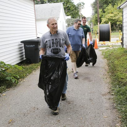 Don Baumis, from left, Paul Hertel and Nick Hardebeck pick up trash in an alley between 11th and 12th streets Wednesday, August 26, 2015, in the Historic Jefferson Neighborhood in Lafayette. Trash bags in hand, volunteers were crisscrossing the neighborhood picking up debris. The cleanup day is part of an effort to organize the neighborhood, especially after concerns about crime.