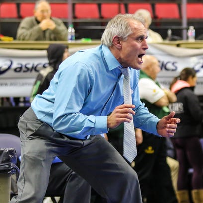 Chenango Forks coach Rick Gumble yells instructions during the 2016 Section 4 Wrestling Tournament at the Floyd L. Manes Veterans Arena in Binghamton. This year, the tournament will move to separate venues, with Corning hosting the Division I tournament and Watkins Glen the Division II tournament.