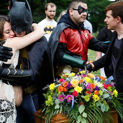 12 Photos: Superheros help ease a families loss