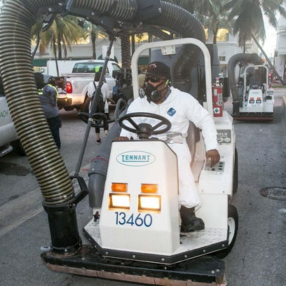 A Miami Beach sanitation worker gets ready to clean the alleyways of South Beach, sucking up still waters and debris with a mobile vacuum, Fridayas part of the city's Zika clean-up.