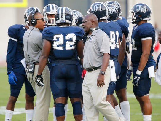 Jackson State players and coaches confer in between