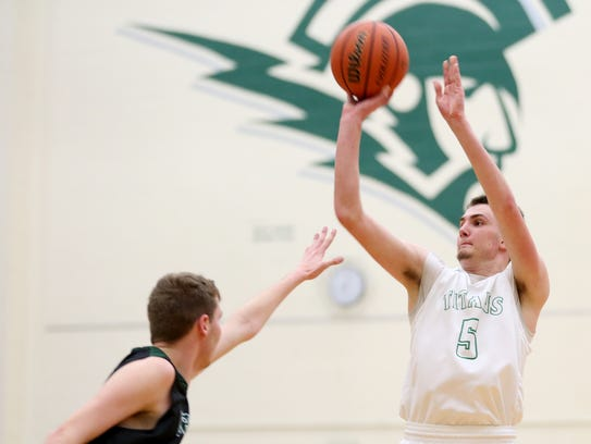West Salem's Kyle Greeley (5) shoots for three points