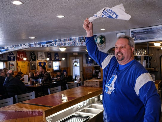 Yooperman's Bar and Grill owner Donnie Stefanski waves