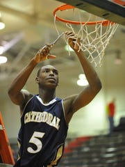 FILE — Cathedral's Jalen Coleman cuts down a piece