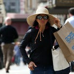 SAN FRANCISCO, CA - AUGUST 13:  A shopper carries a bag from Ross Dress For Less on August 13, 2014 in San Francisco, California. According to a Commerce Department report, July retail sales increased by 0.1 percent, falling short of economist expectations.  (Photo by Justin Sullivan/Getty Images) ORG XMIT: 507040319 ORIG FILE ID: 453567618