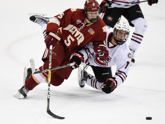 Denver's Henrik Borgstrom and Ryan Poehling of St. Cloud State try to get control of the puck during the first period of the Friday, Jan. 20, game at the Herb Brooks National Hockey Center in St. Cloud.