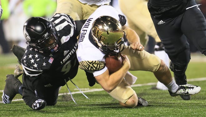 Louisville's Devonte Fields sacks Wake Forest's John Wolford late in the fourth quarter as the Cardinals came back to win 44-12 over Wake Forest Saturday night at Papa John's Cardinal Stadium.
