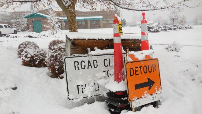 Snow shrouds unused traffic signs in front of B.D. Billinghurst Middle School in northwest Reno on Tuesday.