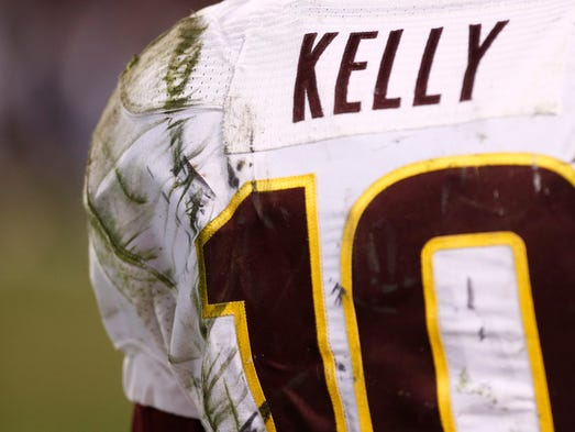 ASU quarterback Taylor Kelly 's is covered in grass stains against Texas Tech in the 4th quarter at the National University Holiday Bowl on Monday, Dec. 30 2013 at Qualcomm Stadium in San Diego, CA.