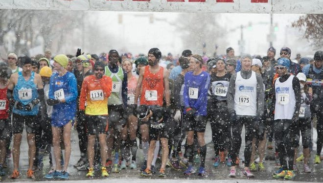 Runners at the start of Fort Collins, Colorado's annual 4-mile Thanksgiving run