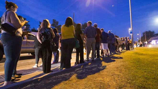 Day goes to night for those waiting to vote.