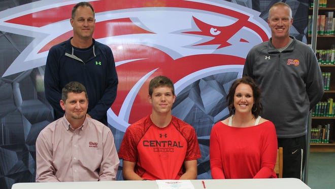 Nixa senior Preston Flood (front, center) signed a letter of intent to play basketball at Central College in Iowa at a ceremony May 4, 2016 at Nixa High School.