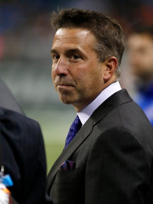Buffalo Bills president Russ Brandon on the field before the game against the New York Jets at Ford Field.