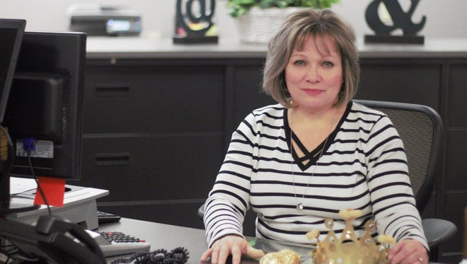 Jodi Rife, who has served as chairwoman of Christmas Clearinghouse for 18 years, sits at her desk at Harding High School, where she works, Wednesday morning. Clearinghouse plans on serving around 1,000 county children this holiday season, providing them with toys, books, food and clothing.