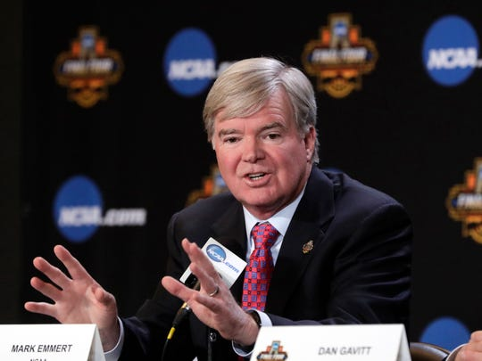 "FILE - In this March 30, 2017, file photo, NCAA President Mark Emmert answers a question at a news conference in Glendale, Ariz. Bank records and other expense reports that are part of a federal probe into college basketball list a wide range of impermissible payments from agents to at least two dozen players or their relatives, according to documents obtained by Yahoo Sports. NCAA president Mark Emmert says in a statement Friday, Feb. 23, 2018, the allegations ""if true, point to systematic failures that must be fixed and fixed now if we want college sports in America."" (AP Photo/Matt York)"