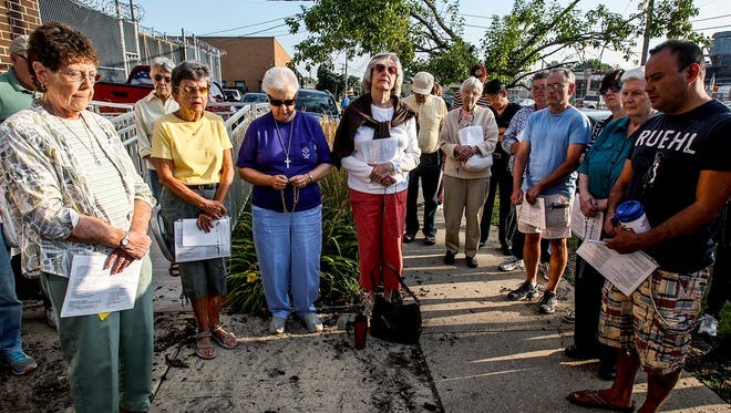 People attend a prayer vigil at the Broadview Immigration Detention Center in Broadview, Ill. Immigrants are brought here as the last stop before being deported back to their native country. Numerous denominations meet every Friday morning to pray for the families and immigrants.