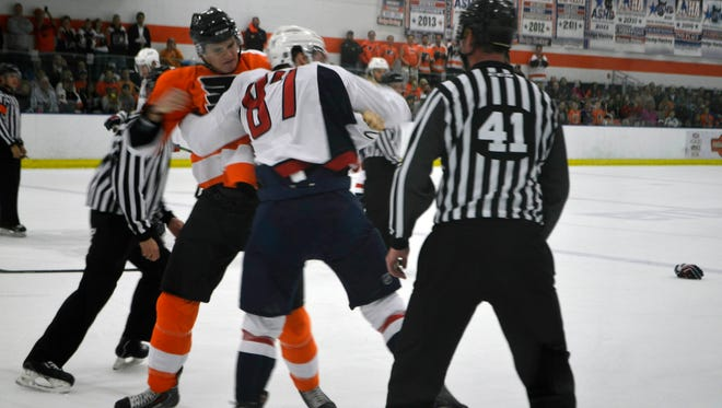 Samuel Morin, left, fought former teammate Liam O'Brien, right, in the first period.