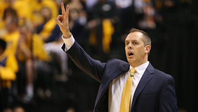 Pacers head coach Frank Vogel talks with the players on the court during the second half of action. Indiana Pacers play the Miami Heat in Game 1 of the NBA Eastern Conference Finals Sunday, May 18, 2014, afternoon at Bankers Life Fieldhouse.