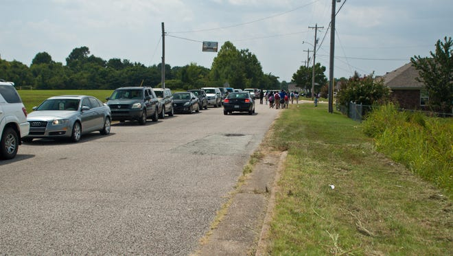 The line of cars outside Northeast Middle School waiting to pick up children from school Wednesday.