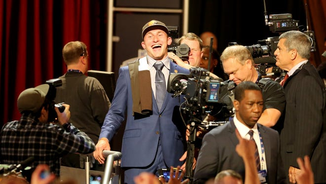 Johnny Manziel is seen leaving the stage after being selected by the Cleveland Browns at the 2014 NFL Draft at Radio City on Thursday, May 8th, 2014 in New York, NY.