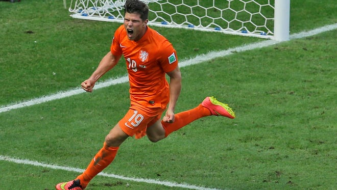 Netherlands' Klaas-Jan Huntelaar celebrates after scoring his side's second goal from the penalty spot during the World Cup round of 16 soccer match between the Netherlands and Mexico at the Arena Castelao in Fortaleza, Brazil, Sunday, June 29, 2014